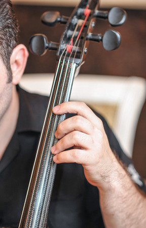 cellist: Man playing the cello hand close up. Cello orchestra musical instrument playing cellist musician Stock Photo