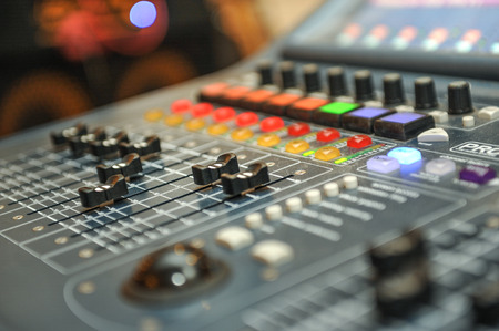 dj mixer: audio mixer, music equipment. recording studio gears, broadcasting tools, mixer, synthesizer. shallow dept of field for music background Stock Photo