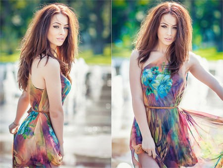 wet dress: Attractive girl in multicolored short dress playing with water in a summer hottest day. Girl with wet dress enjoying fountains. Young beautiful happy female playing with outdoor water fountains. Stock Photo