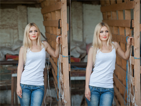 wild hair: Shot of beautiful girl near an old wooden fence. Stylish look wear: white basic top, denim jeans. Country style farmer. Beautiful long hair blonde in rustic style