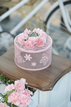 wedding guest: Pink colored wedding decoration with carnations. Table arrangement for luxurious event. Wedding guest table set for an event