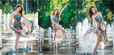colorful dress: Attractive girl in multicolored short dress playing with water in a summer hottest day. Girl with wet dress enjoying fountains. Young beautiful happy female playing with outdoor water fountains. Stock Photo