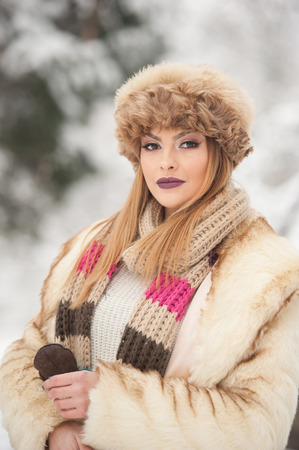 sexy christmas: Attractive young Caucasian adult with brown fur cap. Beautiful blonde girl with gorgeous lips and eyes wearing fur hat, outdoor shot. Makeup - sensual long fair hair female art portrait, winter season Stock Photo