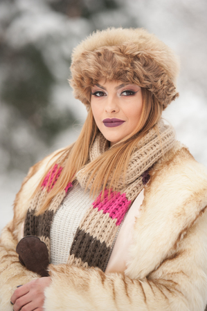 gorgeous girl: Attractive young Caucasian adult with brown fur cap. Beautiful blonde girl with gorgeous lips and eyes wearing fur hat, outdoor shot. Makeup - sensual long fair hair female art portrait, winter season Stock Photo