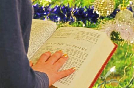 Student studying holy bible at christmas photo