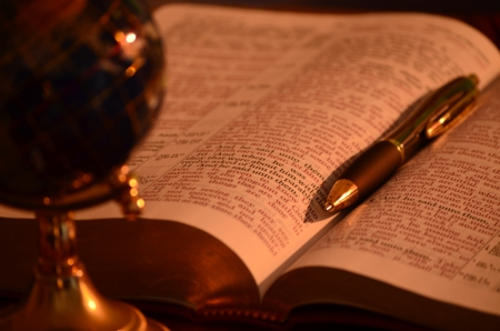Globe, bible and pen photo