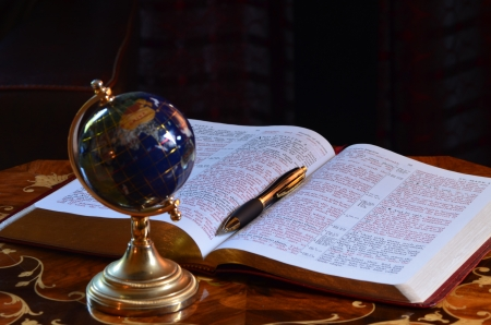 redemption of the world: Globe, bible and pen
