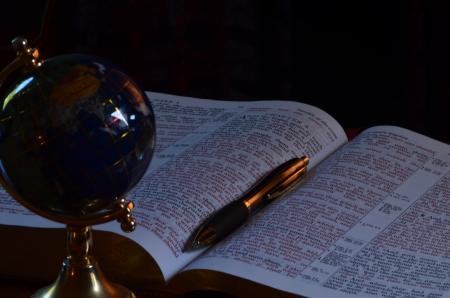 Globe, bible and pen photo