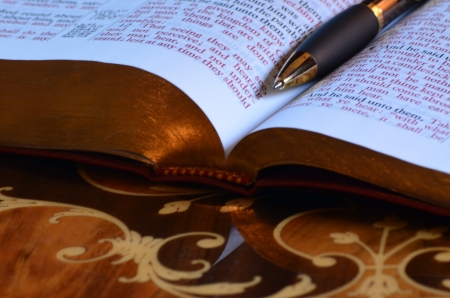 redemption of the world: pen and holy bible Stock Photo