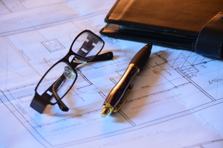 redemption of the world: Architects glasses, blueprints and pen