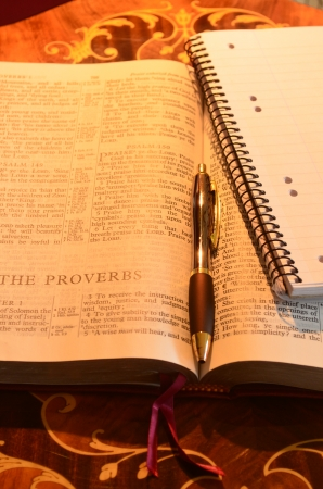 redemption of the world: Holy Bible pen and memo pad Stock Photo
