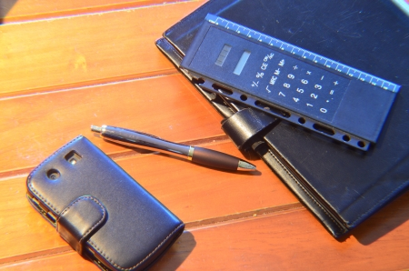 pen organizer and mobile phone photo
