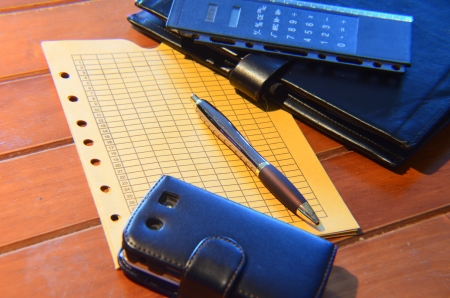 pen, memo pad and leather organizer photo