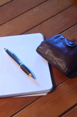 pen, memo pad and leather wallet photo