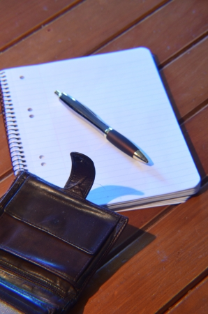 pen and memo pad and leather wallet photo