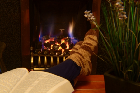 Warm feet in front of roaring fire photo