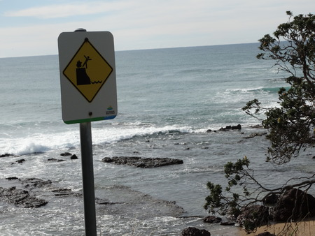 steep cliff sign: Be warned Stock Photo