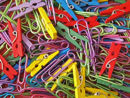 Close-up of multicoloured paper clips and pegs. photo