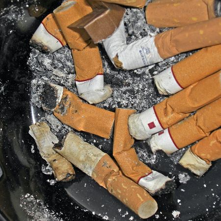 Cigarette butts in an ash tray.