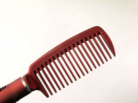Close-up of a plastic comb used for hairstyling.