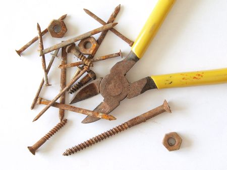 Rusty tools, screws, nails, nuts and bolts. Stock Photo