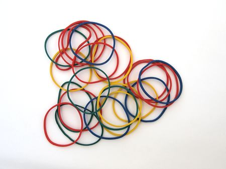 Close-up of colourful rubber bands on a whighr back ground. photo