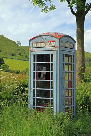 Old phone box in the hills in England. Stock Photo