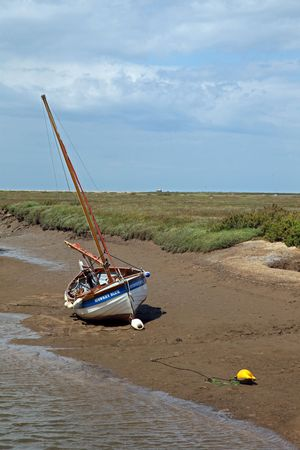 beached: Beached sailing boat in, North Norfolk, England