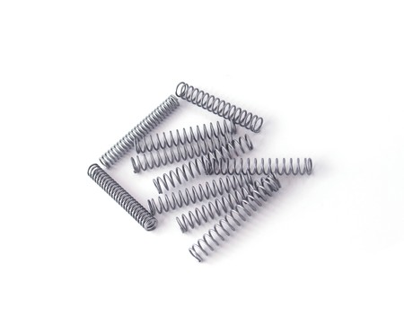 Steel spring on a white background. photo