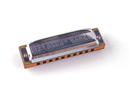 Harmonica or mouth organ on a white background