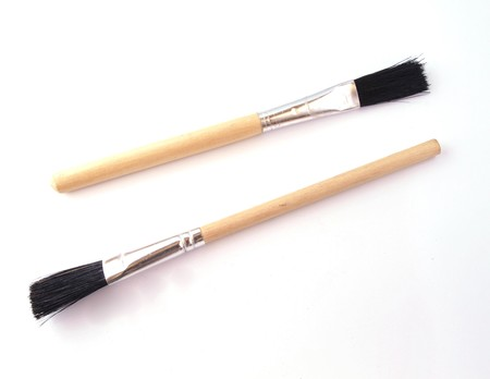 Two new paint brushes on a white background.