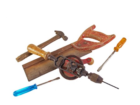 Assorted old hand tools on a plain white background. Stock Photo