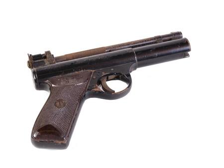Old hand gun on a plain white background. photo