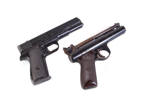 Old hand guns on a plain white background. photo