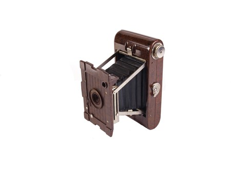 Old camera on a plain white background. Stock Photo