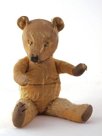 1950 teddy bear sitting down.