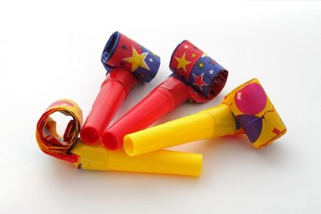 blowers: Party blowers on a plain white background. Stock Photo