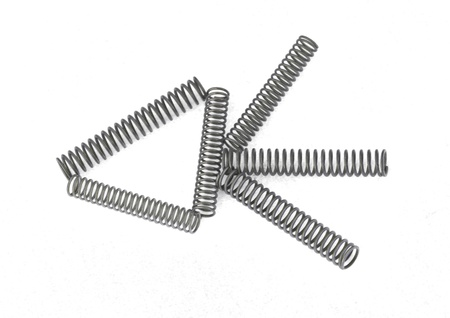 Steel springs on a plain white background.