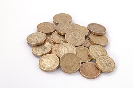 British, UK, pound coins on a plain white background. Foto de archivo