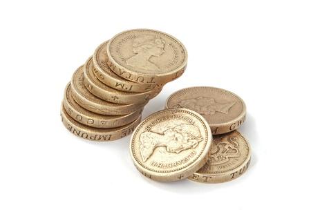 British, UK, pound coins on a plain white background. Stock Photo