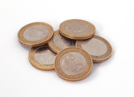 British, UK, two pound coins on a plain white background. Foto de archivo