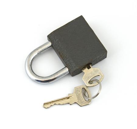 Padlock and key on a plain white background. Stock Photo