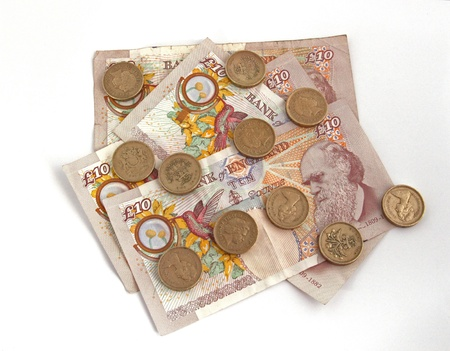 British  uk  currency on a plain background photo