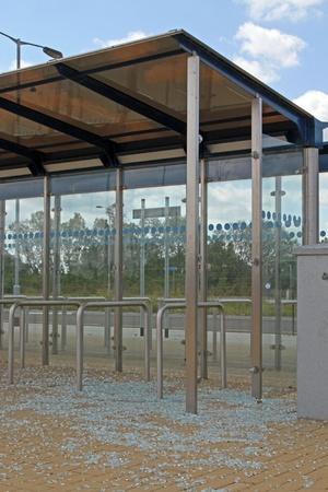 Bus stop vandalised by smashing the glass windows