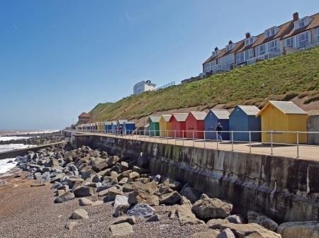 A line of colourful beach huts on the promenade at Sheringham photo