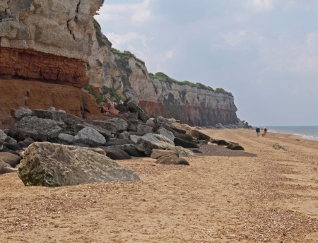 cretaceous: The cliffs at Hunstanton are a famous geological location. The top white layer is Upper Cretaceous chalk. Immediately beneath this is red coloured Lower Cretaceous chalk and beneath that is the red-coloured carstone.