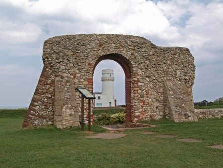 View of the Hunstanton lighthouse through the arch in the remains of St Edmund's Chapel
