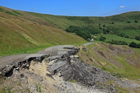 land slide: Mam Tor is a huge moving mountain slowly sliding into the Hope valley near Castleton in Derbyshire