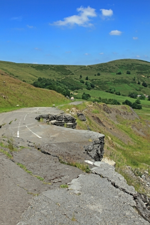 land slide: Mam Tor is a huge moving mountain slowly sliding into the Hope valley near Castleton in Derbyshire.  It is still sliding today as can bee seen by what is left of the old road that was passable until as major slip in 1979. Stock Photo