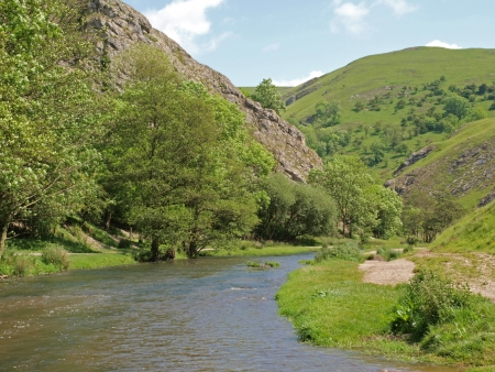 The river Dove as it cuts its way through the limestone rocks forming Dovedale in Derbyshire.  Dovedale is part of the Peak District National Park (214 sq miles) that was created in 1951. It was the first National Park in Briton. Stock Photo
